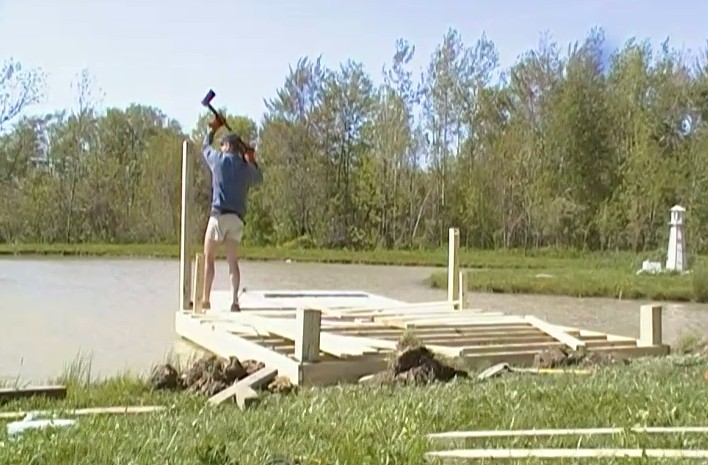 Building A Dock Pier On The Farm Pond Was A Little