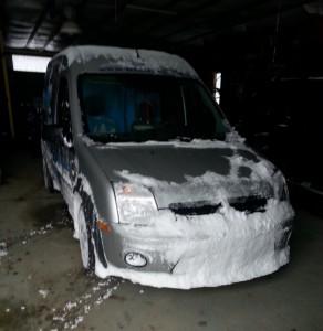 van plowing snow